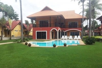 Beachfront two villas on 3200 sqm 30-minute drive south of Hua Hin center